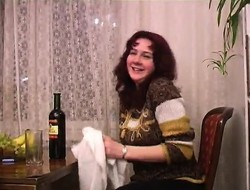 Cute redhead drinks a manliness of regale plus be suitable drops all her rags