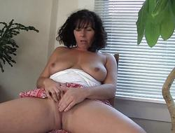 Horny MILF Lynn plays with will not hear of pussy