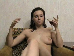 Taking brunette Sasha drinks wine and sensually reveals her hot curvings