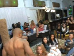 Bald hunky stripper sprays a babe with a hot cumshot