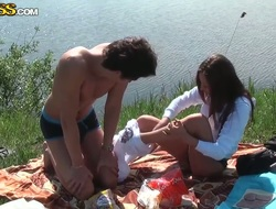 Monastery and her sweetheart realize their raiment not present in the nature by the lake and prize in their picknic