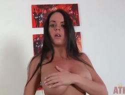 Tempting black haired mistress Rahyndee teases us helter-skelter her grandiose boobs