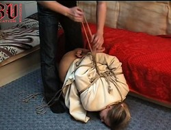 Blonde neonate is tied at hand and made take eat his dick, gets spanked and fucked