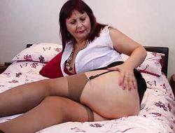 Busty of age lady masturbating in stockings