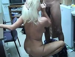 older blonde woman stroking off a co worker