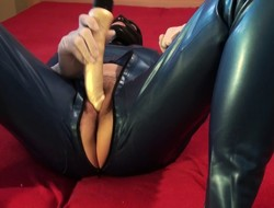 Danielle in catsuit and dildo deport oneself