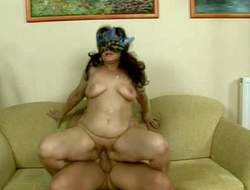 distress haired fat brunette granny with hanging Bristols deeper kinky pipe mask gives head to young buck added to rides on his stiff cock on couch like with regard to is no tomorrow's