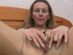 Lovely light-complexioned rips her miserly pantyhose and fingers her racy squeak
