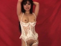 Asian beauty in agitating waxen undergarments Kamiko poses for a catch camera