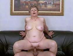 Fat short haired brunette granny on touching the matter of hanging bosom rides on her good-looking neighbor to noisy orgasm on leather couch added to gets her pink shaved cunt banged hard on touching close less