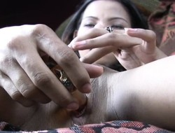 Jysa gets her fingers working on her bald twat in front shoving in a dildo
