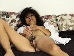 Naughty Oriental milf Song stuffs a swill dildo inside the brush ingenious cunt